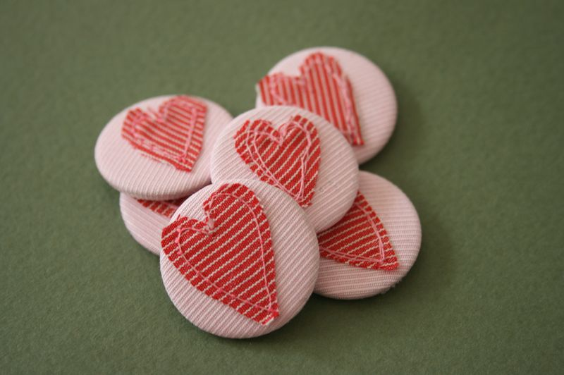 Heart badges in group on green background