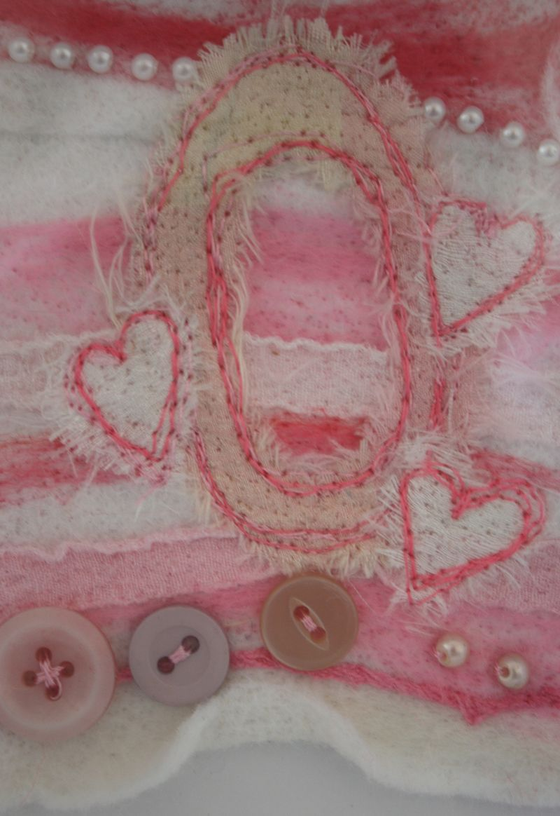 O close up on O, hearts and buttons