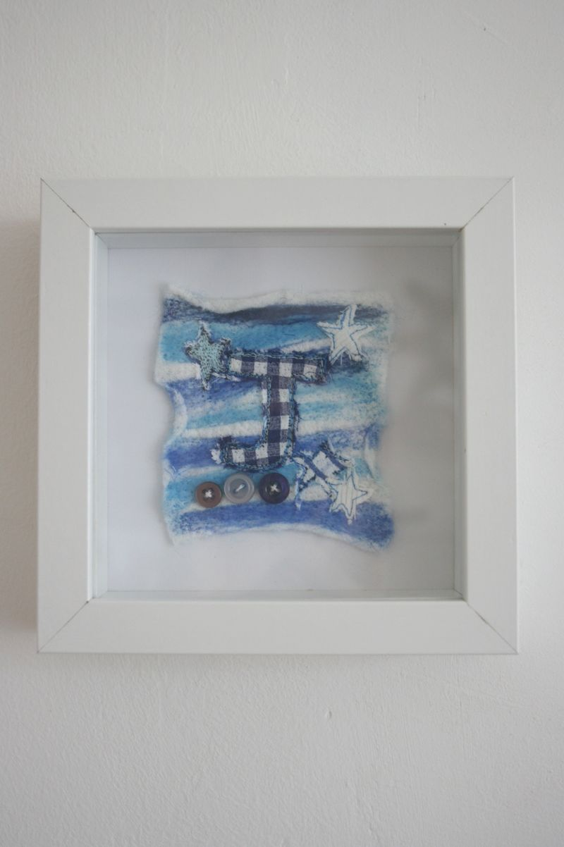 Small Blue J on wall