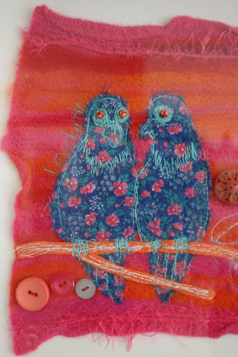 Lovebirds close up on left hand side