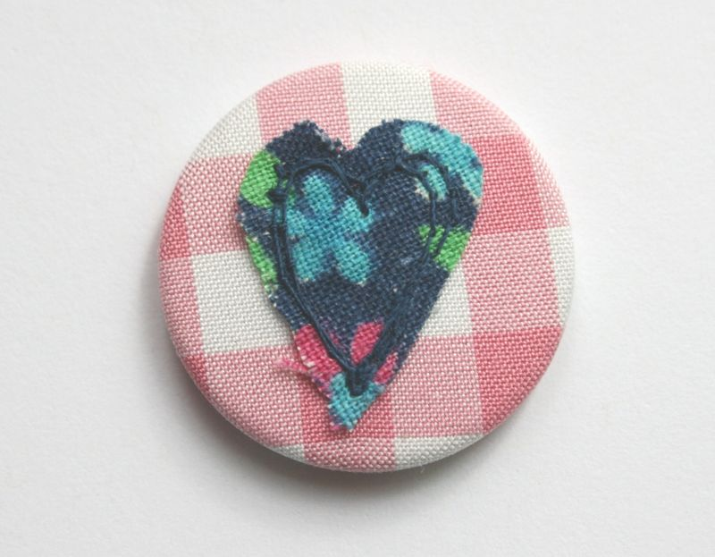 Heart navy on pink close up on white background