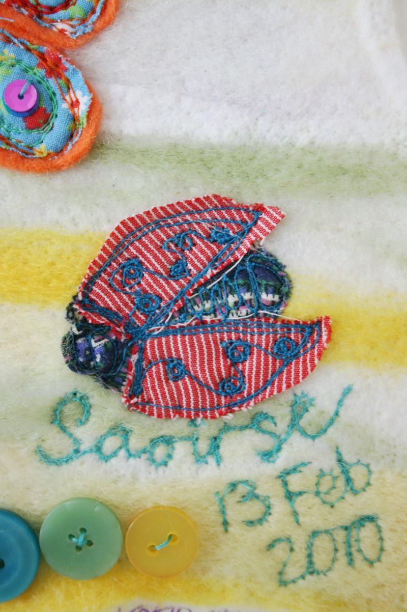 Saoirse close up on ladybird and name
